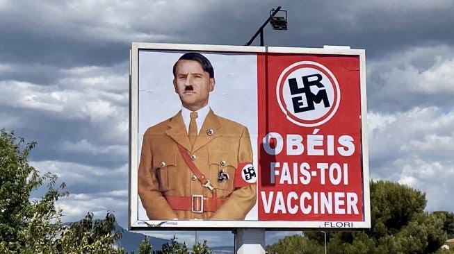 Described as Adolf Hitler, President Emmanuel Macron Files Lawsuit